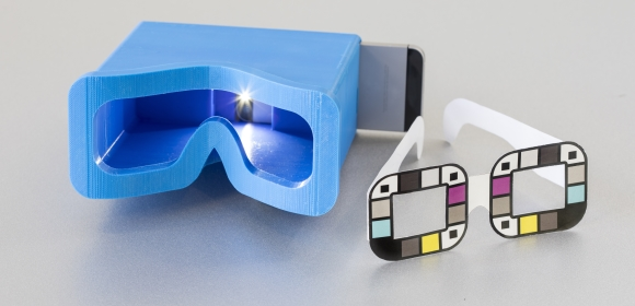 The UW team tested two different accessories for BiliScreen: a 3-D printed box to control lighting conditions and glasses that help the app calibrate colours. | Credit: Dennis Wise/University of Washington