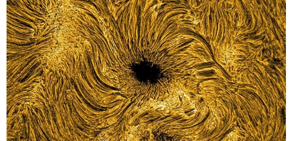 A view of a sunspot on the solar surface, visible here as a dark collection of plasma with magnetic field strengths similar to those found in modern hospital MRI machines. | Credit: Emma Gallagher, Queen's University Belfast