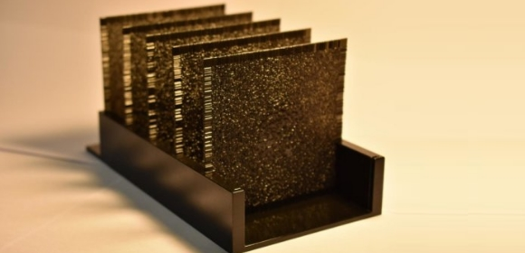 The device's network, composed of a series of polymer layers, works using light that travels through it. Each layer is 8 centimetres squared | Credit: UCLA Samueli / Ozcan Research Group