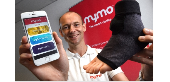 Craig Downs with a wearable sock that uses artificial intelligence to monitor a runner's gait before sending the information to a smartphone