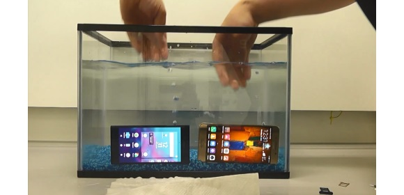 Fig 3. phones have sim card holders removed to let in water (bottom right), and are returned to the water (see bubbles rising as water enters)