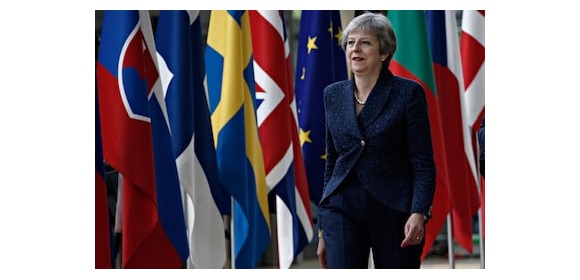 Theresa May Brussels UK EU flags