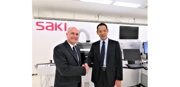 L to R_Mitch DeCaire, Global Director – Equipment Partnerships, Cogiscan with Norihiro Koike, President, SAKI Corporation.jpg